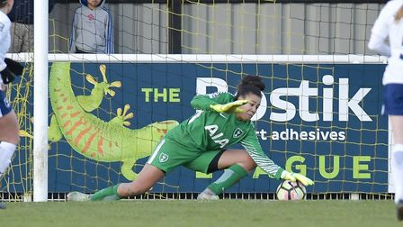 Tottenham Hotspur Ladies goalkeeper Chloe Morgan gets down low to stop the ball from finding her net