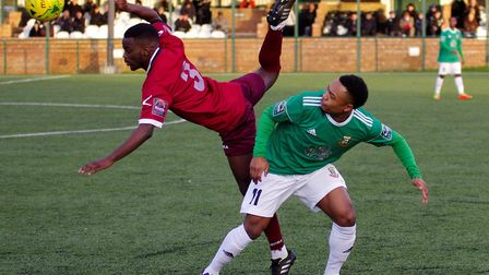 Hendon's Ashley Nathaniel George is beaten to the ball by Wingate & Finchley defender Nathan Mavilla