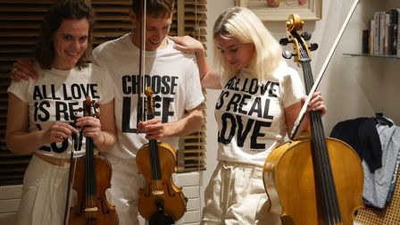 Daniel Chandler and his violin, with friends Beatrice Phillips (left) and Clean Bandit's Grace Chatt