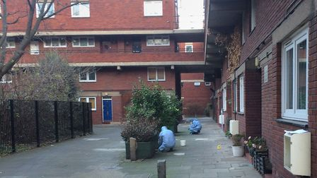 Forensic officers at the scene of a stabbing at Bartholomew Court. Picture: Luke Mintz/PA Wire
