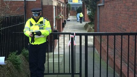Forensic officers at the scene of the stabbing in Bartholomew Court, off Old Street. Picture: Luke M