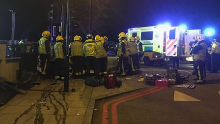 Fire crews cut two men free after the crash in Seven Sisters Road, Finsbury Park, last night. Pictur