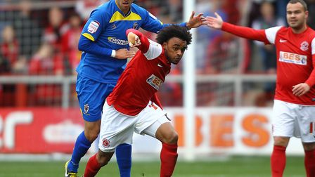 Fleetwood Town's Junior Brown and AFC Wimbledon's George Francomb battle for the ball (pic: PA Image