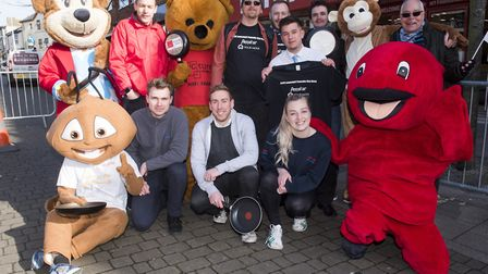 Competitors at the end of the Lowestoft 2018 pancake race.Picture: Nick Butcher