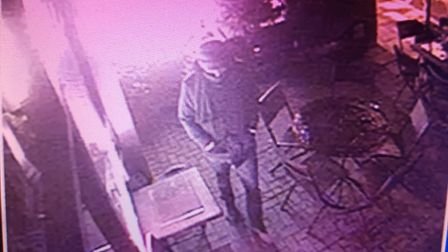 A CCTV image of a man in Tuana restaurant in Colney Hatch Lane, where �2,000 worth of damage was cau