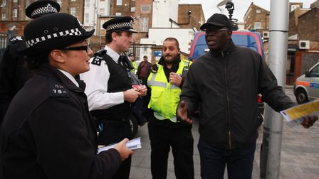 Police officers take part in a community action day at Gillett Square, Hackney