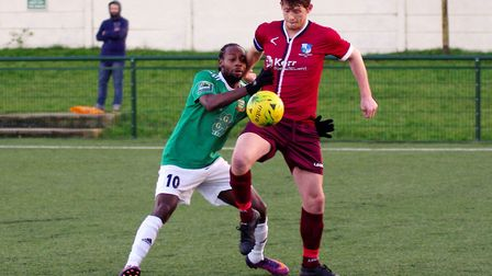 Wingate & Finchley defender Sean Cronin holds off Hendon rival Niko Muir (pic: DBeechPhotography)