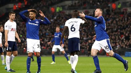 Everton's Wayne Rooney (right) celebrates briefly before seeing his goal disallowed for being offsid