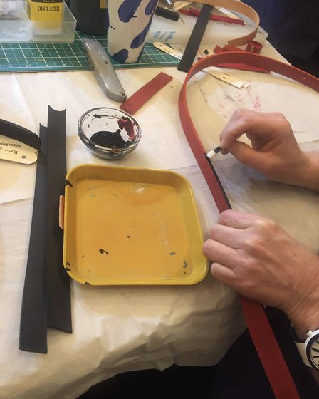 Staining the edges of the leather at Kate Sheridan's leather bag making workshop