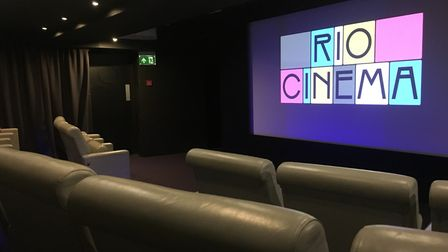 The new basement screen at the Rio, and the plush leather chairs
