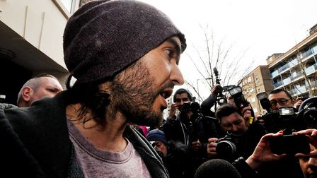 Russell Brand arrives at the opening of the Trew Era cafe, a social enterprise community project on