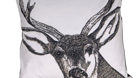 Seasonal touches like this Stag Print cushion cover are a lovely touch