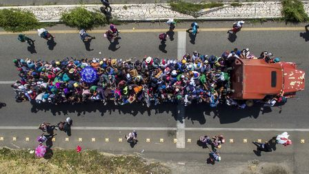Aerial view of Honduran migrants onboard a truck as they take part in a caravan heading to the US, i
