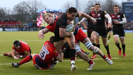 Saracens' Sean Maitland holds off Worcester's Chris Pennell and David Denton during the Aviva Premie