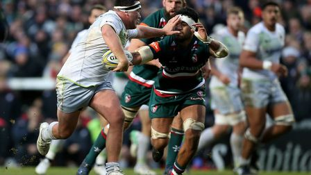 Saracens' Jamie George (left) holds off Leicester Tigers' Valentino Mapapalangi and goes in to score