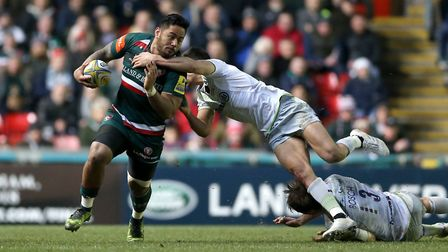 Leicester Tigers' Manu Tuilagi (left) is tackled by Saracens' Alex Lozowski during their Aviva Premi