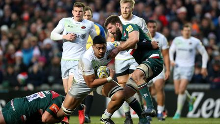 Saracens' Alex Lozowski (centre) is tackled by Leicester Tigers' Tom Youngs (left) and Michael Fitzg