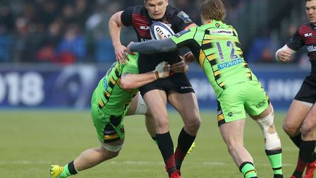 Saracens' Owen Farrell and Northampton Saints' Tom Stephenson during the European Rugby Champions Cu