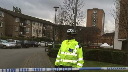 Police remain at the scene on the George Downing Estate. Picture: Emma Bartholomew