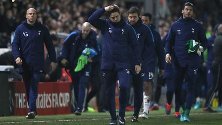 Tottenham Hotspur manger Mauricio Pochettino (centre) after the full time whistle at Newport County