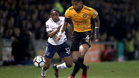 Tottenham Hotspur's Kyle Walker-Peters (left) and Newport County's Joss Labadie battle for the ball