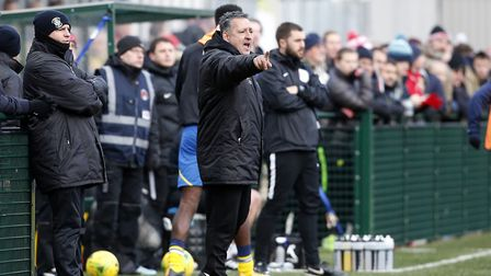 Tom Loizou issues instructions to his Haringey Borough team from the touchline against Leyton Orient