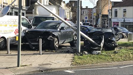 An Audi Q7 and a convertible BMW were badly damaged in the collision. Picture: Thomas Chapman