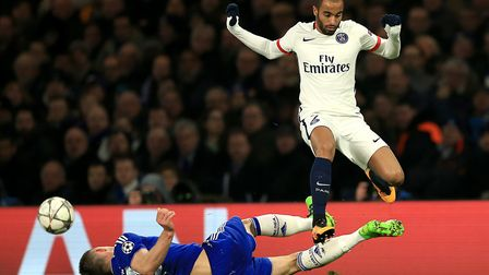 Paris Saint Germain's Lucas Moura (right) and Chelsea's Gary Cahill battle for the ball (pic: John W