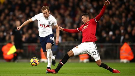 Tottenham Hotspur's Harry Kane (left) and Manchester United's Chris Smalling battle for the ball dur