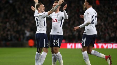 Tottenham Hotspur's Kieran Trippier (left) celebrates after his cross is turned in by Manchester Uni