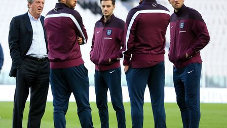 England manager Roy Hodgson (left) speaks to Andros Townsend (centre left), Ryan Mason (centre) and
