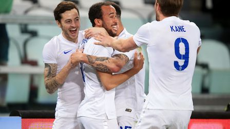 England's Andros Townsend celebrates with his club team-mates Ryan Mason (left), Kyle Walker (centre