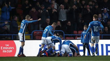 Rochdale's Ian Henderson is mobbed by his team-mates as he celebrates scoring against Tottenham Hots