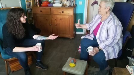 Rowena at home speaking to Dunia, a coaching ally from Out and About. Picture: Anne-Marie Payne