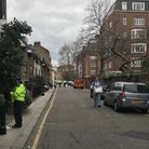 Police and forensic officers in Logan Place, Kensington, west London after a 19 year old was discove