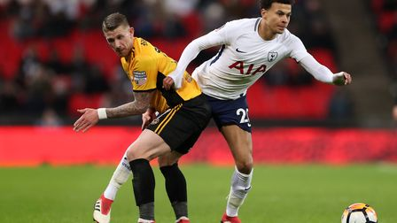 Tottenham Hotspur's Dele Alli and Newport County's Scot Bennett during the Emirates FA Cup, fourth r