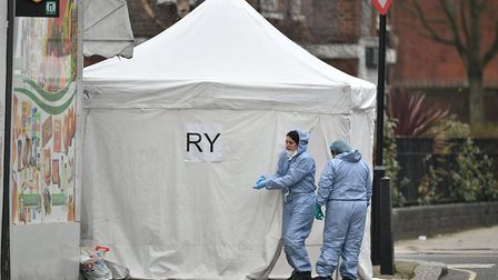 Police forensics officers at the scene in Bartholomew Road. Photo: Dominic Lipinski/PA Wire