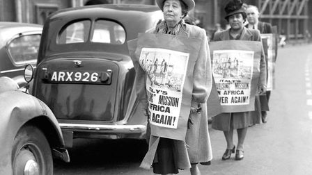 Sylvia Pankhurst leads marchers outside the House of Commons during protests against any proposal to