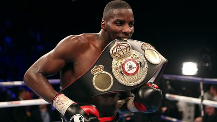 Lawrence Okolie celebrates defeating Isaac Chamberlain on points during the WBA Continental cruiserw