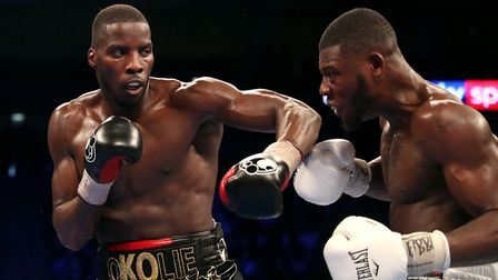 Lawrence Okolie (left) and Isaac Chamberlain during the WBA Continental cruiserweight championship b