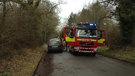 Firefighters arrived on scene to secure the car after the quick-thinking cyclists doused the flames,