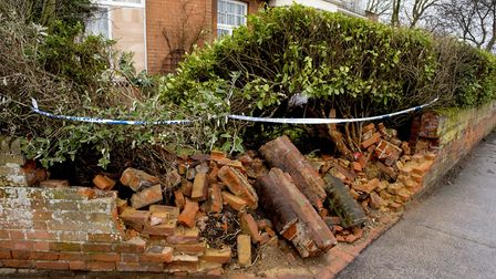 A wall was demolished and a window was broken when a car crashed into the front garden of a home on