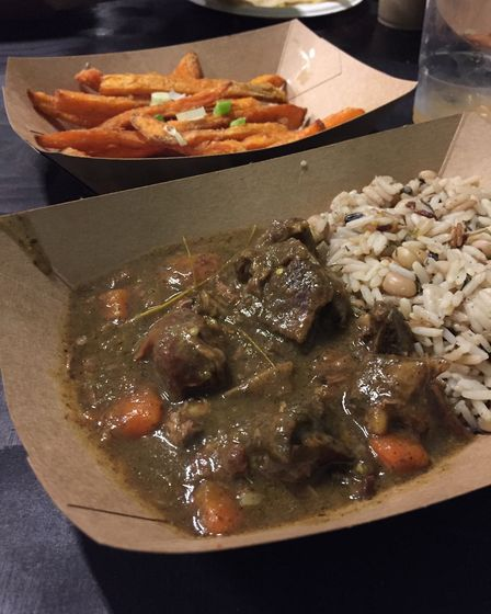 Curried goat with rice and peas at Rudie's Boxpark