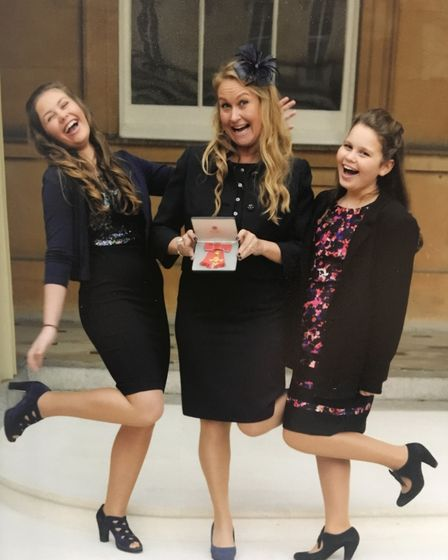 Sarah Bailey picking up her OBE, with her daughters. Picture: Michael Bailey