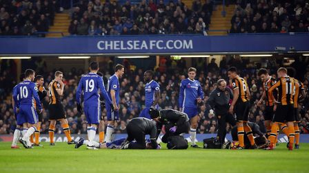 Hull City's Ryan Mason (right) and Chelsea's Gary Cahill lie injured on the floor during the Premier