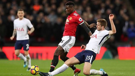 Manchester United's Paul Pogba (left) and Tottenham Hotspur's Eric Dier battle for the ball (pic: Ad