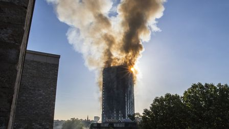 Smoke billows from Grenfell Tower in Kensington the day after the fire that killed 71 people. Hackne