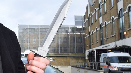 Det Insp Paul Ridley shows the Gazette one of the blades taken off Hackney's streets through stop an