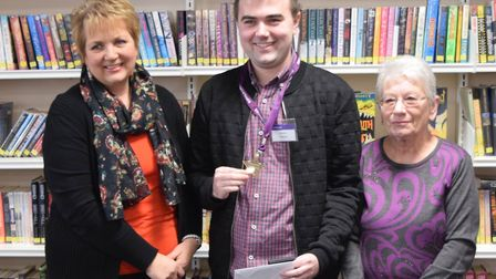 Christian Hutchings with his mum Rosie and his grandmother receiving the Suffolk Libraries Volunteer