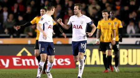 Tottenham Hotspur's Harry Kane (right) celebrates scoring his side's goal at Newport County in the F